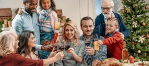 large family clinking glasses on christmas dinner