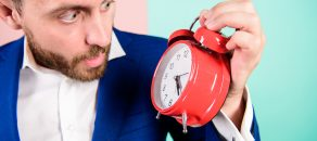 Businessman has lack of time. Time management skills. How much time left till deadline. Time to work. Man bearded surprised businessman hold clock. Stress concept. Mature man with wondering